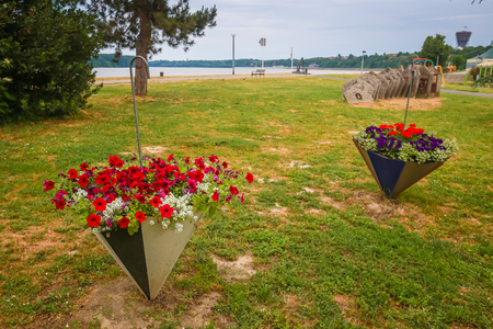 A view of flowers in umbrellas used as pots in a park on the coast of river Danube in Vukovar, Croatia.
