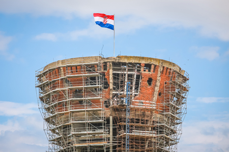 A view of the Vukovar water tower under reconstruction and  intended to be a memorial place in Vukovar, Croatia. It is a symbol of the city suffering in the Croatian War of Independence. Stock Photo
