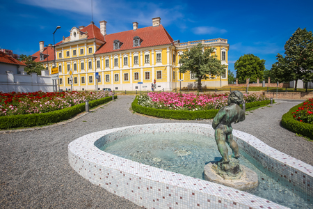 VUKOVAR, CROATIA - MAY 14, 2018 : View of a water fountain with statue and flowers in a park with the City museum located in the Eltz castle in the background  in Vukovar, Croatia. Editorial