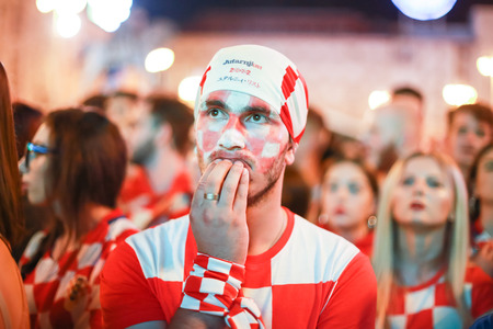 ZAGREB, CROATIA - JUNE 16TH, 2018 : Croatian football fans watching on the big screen football game of Croatia vs Nigeria on Fifa World cup 2018 on Ban Jelacic Square in Zagreb, Croatia.
