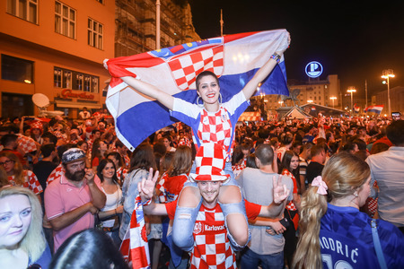 ZAGREB, CROATIA - JULY 7TH, 2018 : Croatian football fans celebrate Croatian quarter final victory over Russia on Fifa World cup 2018 on Ban Jelacic Square in Zagreb, Croatia. Редакционное