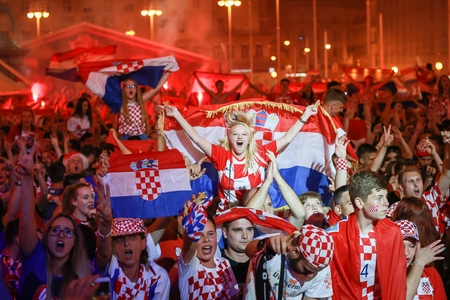 ZAGREB, CROATIA - JULY 7TH, 2018 : Croatian football fans celebrate Croatian quarter final victory over Russia on Fifa World cup 2018 on Ban Jelacic Square in Zagreb, Croatia. Éditoriale