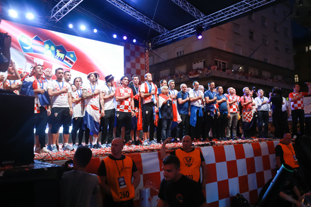 ZAGREB, CROATIA - JULY 16, 2018 : Croatia National Football Team while anthem playing on the stage during welcome home celebration on Ban Jelacic Square. Imagens - 106177185