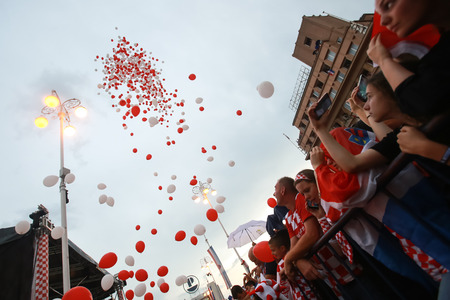 ZAGREB, CROATIA - JULY 16, 2018 : Croatia National Team welcome home celebration for 2nd place on Fifa World Cup 2018 - Releasing balloons before arrival of football players on Ban Jelacic square.