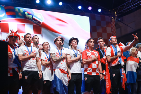 ZAGREB, CROATIA - JULY 16, 2018 : Croatian football national team singing Croatian anthem on the stage during welcome home celebration on Ban Jelacic Square in Zagreb Croatia.