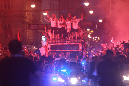 ZAGREB, CROATIA - JULY 16, 2018 : Croatia National Team welcome home celebration for 2nd place on Fifa World Cup 2018 - Croatia National Team arriving with the open bus through the Ilica street. Imagens - 106177277