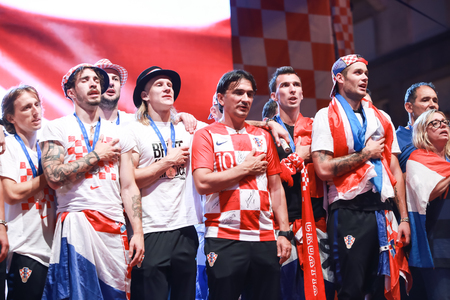 ZAGREB, CROATIA - JULY 16, 2018 : Croatia National Football Team while anthem playing on the stage during welcome home celebration on Ban Jelacic Square. Editorial