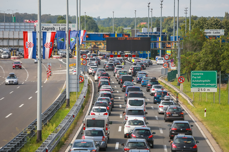ZAGREB, CROATIA - August 11th, 2018 : Big traffic jam due to the large number of tourists going to the sea coast of Croatia in the Lucko highway toll in Zagreb, Croatia. Sajtókép