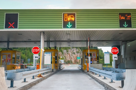 Ostrovica, Croatia - August 1th, 2018 : Cars driving on the highway tollbooth Ostrovica at sunset in Ostrovica, Croatia.