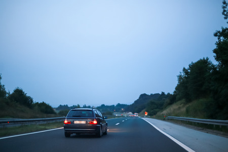 Car driving on the highway at sunset. Stok Fotoğraf