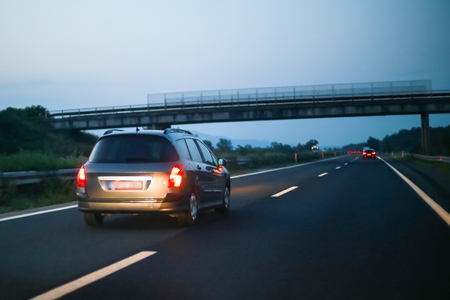 Car driving on the highway at sunset. Banco de Imagens