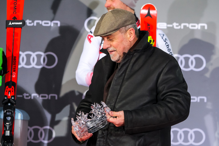 Zagreb, Croatia - January 6, 2019 : Award ceremony of the Audi FIS Alpine Ski World Cup Mens Slalom, Snow Queen Trophy 2019. Zagreb mayor Milan Bandic with glass crown as a cup for the winner. Editorial