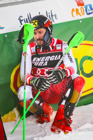 Zagreb, Croatia - January 6, 2019 : Award ceremony of the Audi FIS Alpine Ski World Cup Mens Slalom, Snow Queen Trophy 2019. Marcel Hirscher talking on the phone stuck at his helmet. Editorial