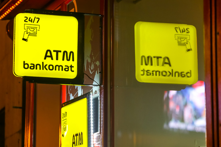 Close up of Atm machine yellow sign on the street during night. Stock Photo - 118947922