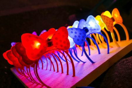 Colorful illuminating bow hairbands lined up for sale. Stock Photo - 118985566