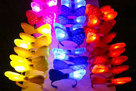 Colorful illuminating bow hairbands lined up for sale.