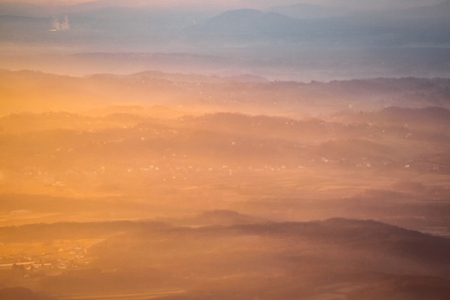 A view of the sunset over the village and mountain peaks. Stock Photo - 118985580