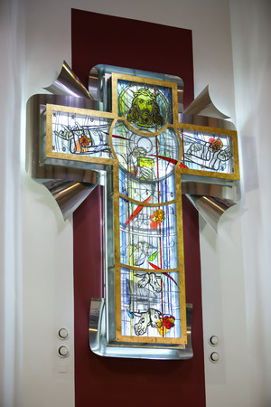 Zagreb, Croatia - May 11, 2019 : Detail of the big modern artistic cross with Jesus Christ on the glass in the Church of St. Nikola Bishop in Zagreb, Croatia.
