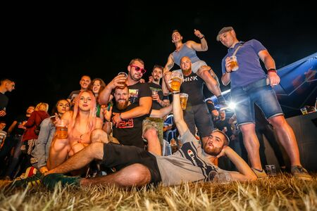 Brezje, Croatia - 20th July, 2019 : Group photo of friends posing and goofing around on the Forestland, ultimate forest electronic music festival located in Brezje, Croatia.