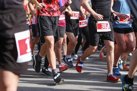 A front view of people running at the half marathon event. Stock Photo