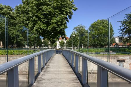 Modern metal glass pedestrian bridge over the road in downtown of Zagreb, Croatia