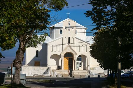 Udbina, Croatia - October 8, 2019 : Modern new Church of the Croatian Martyrs made 2010 year.The cornerstone was blessed by the Pope John Paul II. Statue of Pope John Paul II in front of the church.