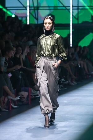 Zagreb, Croatia - October 24, 2019 : A model wearing Les Emaux fashion collection on the catwalk at the Bipa Fashion.hr fashion show in Zagreb, Croatia.