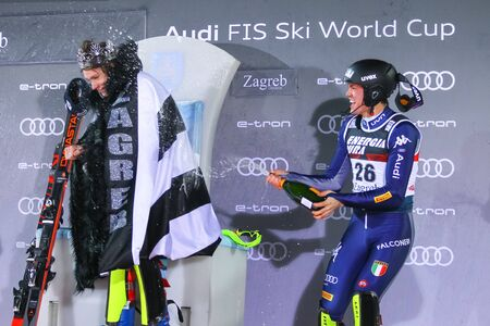Zagreb, Croatia - January 5, 2020 : 1st placed Clement Noel and 3rd placed Alex Vinatzer during award ceremony of the Audi FIS Alpine Ski World Cup Mens Slalom, Snow Queen Trophy 2020.