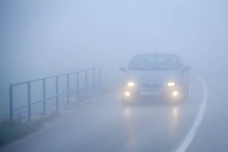 Zagreb, Croatia - 27th October, 2019 : Traffic on the two way road during thick morning fog.