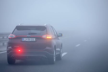Zagreb, Croatia - 27th October, 2019 : Traffic on the highway during thick morning fog.