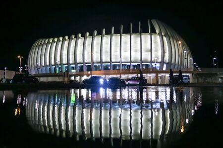 Zagreb, Croatia - December 28, 2019 : A view of the Arena Zagreb at night with reflection in Zagreb, Croatia. Arena Zagreb is the largest sports arena in Croatia. Publikacyjne