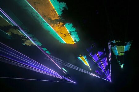 Colorful laser and stage lights isolated on black, laser show. 版權商用圖片
