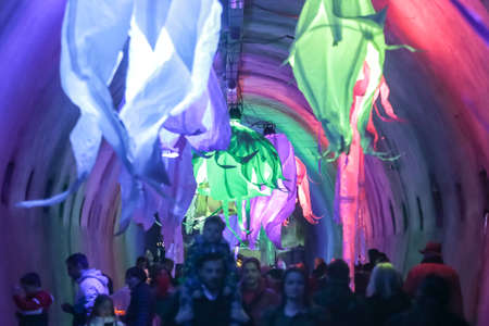 Zagreb, Croatia - 16 March, 2018 : Festival of lights. People walking through a lighted tunnel Gric with lighted colorful abstract chandeliers in the center of Zagreb.