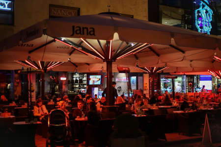 Zagreb, Croatia - 19 March, 2017 : People enjoying a drink on the terrace of the cafe bar during the night in downtown of Zagreb, Croatia.
