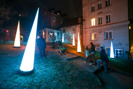 Zagreb, Croatia - 19 March, 2017 : Festival of lights in Zagreb, Croatia. People walking next to the lighting installations in center of Zagreb.
