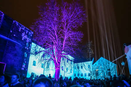 Zagreb, Croatia - 19 March, 2017 : Festival of lights in Zagreb, Croatia. People looking at illuminated wood and buildings and presentation of light beams on the upper town in Zagreb, Croatia.