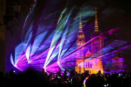 Zagreb, Croatia - 19 March, 2017 : Festival of lights in Zagreb, Croatia. People watch a laser show near Klovicevi dvori in the upper town with a view of the Zagreb Cathedral. 報道画像
