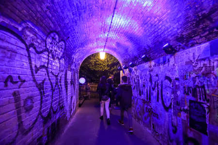Zagreb, Croatia - 19 March, 2017 : Festival of lights in Zagreb, Croatia. People walking through a illuminated tunnel in the center of Zagreb.
