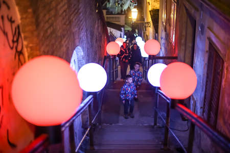 Zagreb, Croatia - 19 March, 2017 : Festival of lights in Zagreb, Croatia. People on the stairs to the upper town with installed color ball lamps, next to the funicular in the center of Zagreb.
