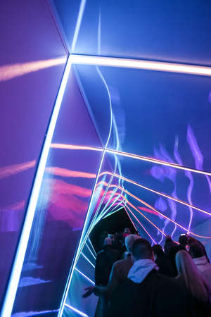 Zagreb, Croatia - 19 March, 2017 : Festival of lights in Zagreb, Croatia. People walking through a lighted tunnel installation with colorful neon lights in the center of Zagreb. 報道画像