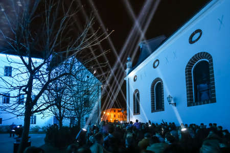 Zagreb, Croatia - 19 March, 2017 : Festival of lights in Zagreb, Croatia. People looking at illuminated buildings and presentation of light beams on the upper town in Zagreb, Croatia.