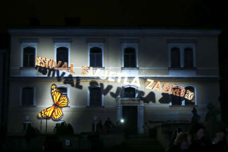 Zagreb, Croatia - 19 March, 2017 : Festival of lights in Zagreb, Croatia. People watch an animated projection on a building in the upper town in Zagreb, Croatia. 報道画像