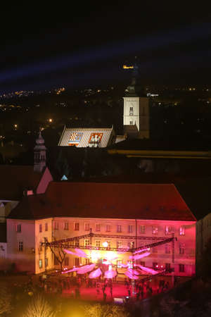 Zagreb, Croatia - 24 March, 2019 : Festival of lights in Zagreb, Croatia. View of the lighting installations on a plateau of Klovicevi palaces in the upper town with St. Mark Church in the background. Editorial
