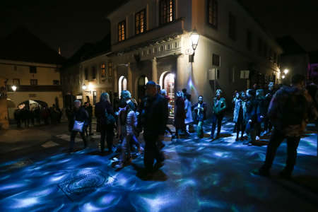 Zagreb, Croatia - 24 March, 2019 : Festival of lights in Zagreb, Croatia. People walk down a lighted street in the upper town during the night.