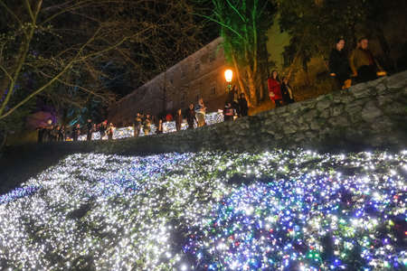 Zagreb, Croatia - 24 March, 2018 : People walking on illuminated park like flowers in a Vrazs promenade in upper town of Zagreb. Editorial