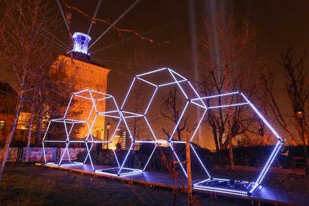 Zagreb, Croatia - 24 March, 2019 : Festival of lights in Zagreb, Croatia. Illuminated hexagons of construction stacked on top of each other in upper town.