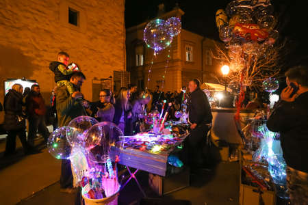 Zagreb, Croatia - 24 March, 2019 : People buying light props at the booth in the upper town during Festival of lights in Zagreb.