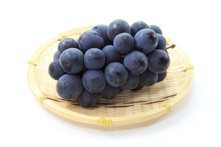 catchphrases: Grapes on the bamboo plate Stock Photo