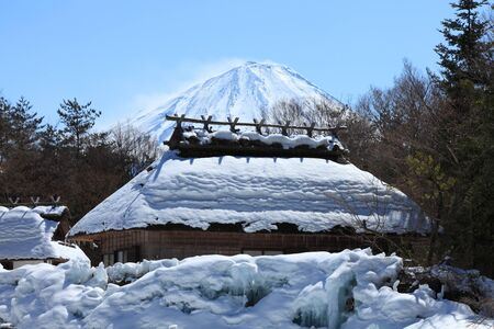 Mount Fuji and the thatched roof house