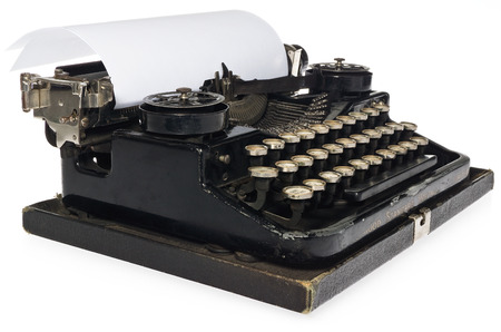 Black antique typewriter with white blank sheet of paper. Side view on a white background, view of the mechanism and view of the old font. The Possibility of applying or description on the card